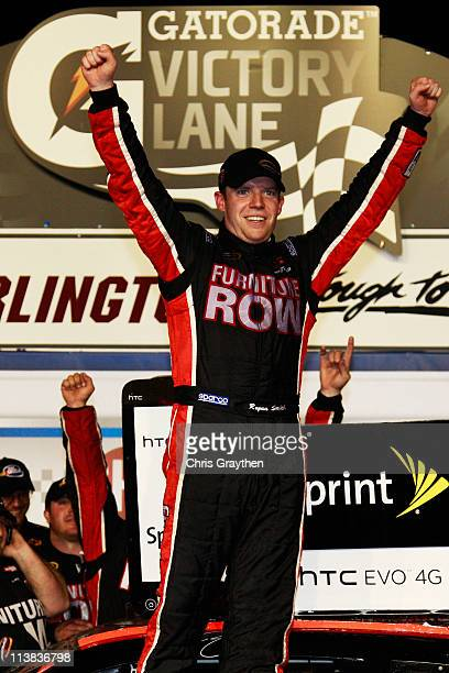 Regan Smith driver of the Furniture Row Companies Chevrolet celebrates in Victory Lane after winning the NASCAR Sprint Cup Series SHOWTIME Southern...