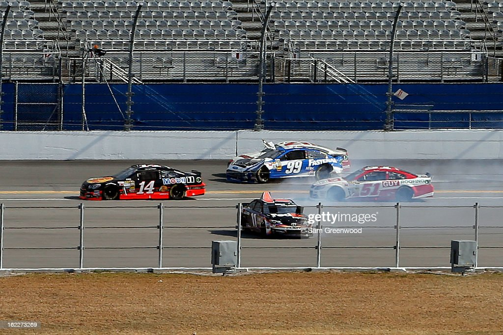 Regan Smith driver of the Guy Roofing Chevrolet Denny Hamlin driver of the FedEx Express Toyota Carl Edwards driver of the Fastenal Ford and Trevor...