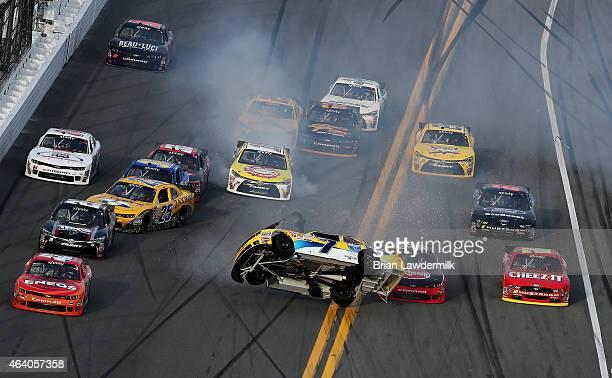 Regan Smith driver of the Hellmann's Chevrolet flips ahead of Austin Dillon driver of the Rheem Chevrolet during the NASCAR XFINITY Series Alert...