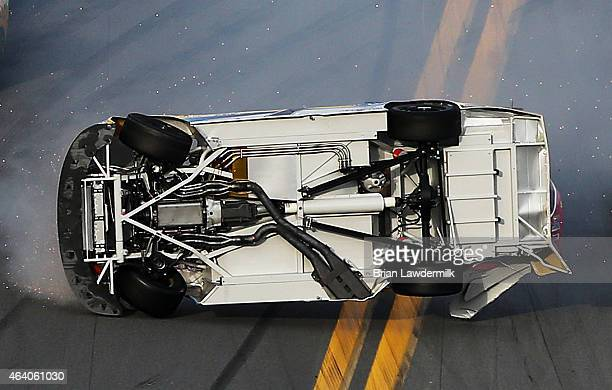 Regan Smith driver of the Hellmann's Chevrolet flips during a large ontrack incident during the NASCAR XFINITY Series Alert Today Florida 300 at...