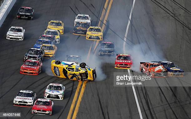 Regan Smith driver of the Hellmann's Chevrolet flips during an ontrack incident involving Daniel Suarez driver of the ARRIS Toyota Chase Elliott...