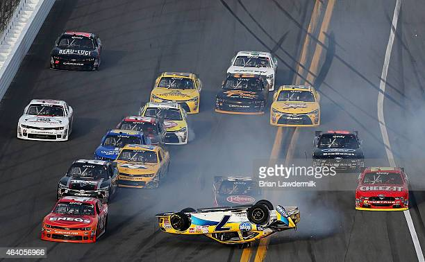 Regan Smith driver of the Hellmann's Chevrolet flips over during an ontrack incident with during the NASCAR XFINITY Series Alert Today Florida 300 at...