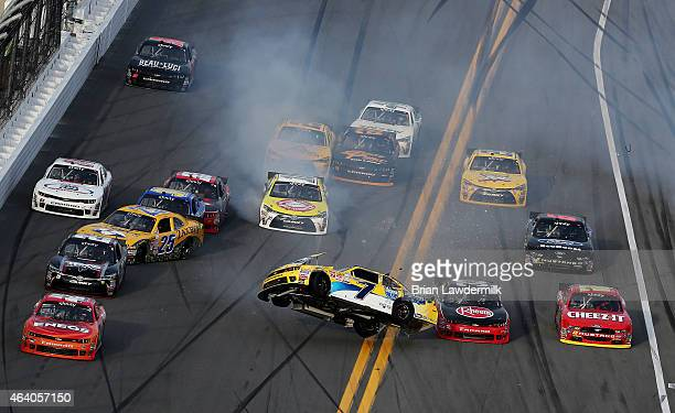 Regan Smith driver of the Hellmann's Chevrolet flips over during an ontrack incident during the NASCAR XFINITY Series Alert Today Florida 300 at...