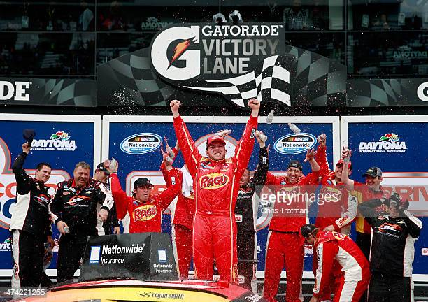 Regan Smith driver of the Ragu Chevrolet celebrates in Victory Lane after winning during the NASCAR Nationwide Series DRIVE4COPD 300 at Daytona...
