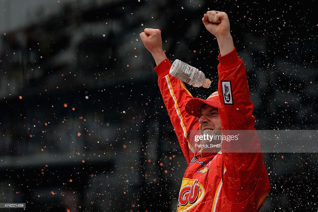 Regan Smith, driver of the #7 Ragu Chevrolet, celebrates in Victory Lane after winning during the NASCAR Nationwide Series DRIVE4COPD 300 at Daytona International Speedway on February 22, 2014 in Daytona Beach, Florida.