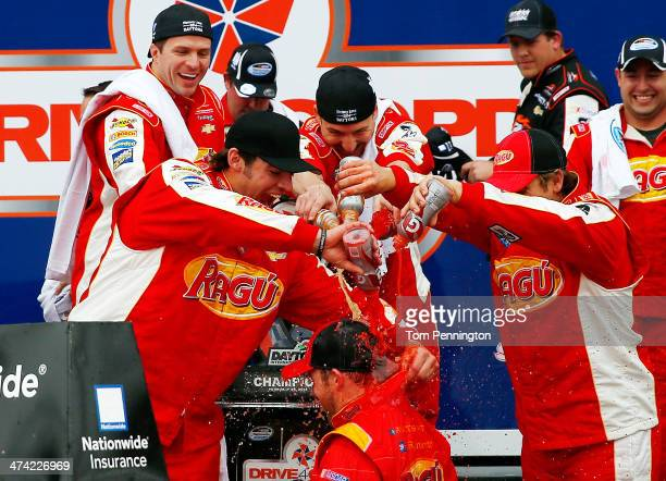 Regan Smith driver of the Ragu Chevrolet celebrates in Victory Lane after winning after winning the NASCAR Nationwide Series DRIVE4COPD 300 at...