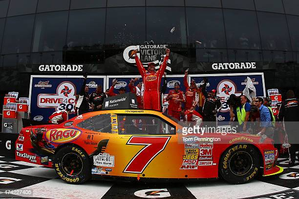 Regan Smith driver of the Ragu Chevrolet celebrates in Victory Lane after winning the NASCAR Nationwide Series DRIVE4COPD 300 at Daytona...
