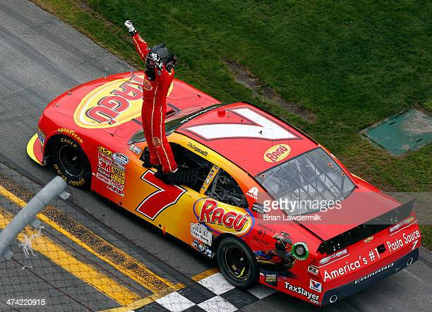 Regan Smith driver of the Ragu Chevrolet celebrates winning the NASCAR Nationwide Series DRIVE4COPD 300 at Daytona International Speedway on February...