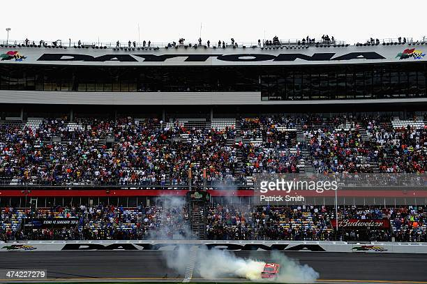 Regan Smith driver of the Ragu Chevrolet celebrates with a burnout after winning the NASCAR Nationwide Series DRIVE4COPD 300 at Daytona International...