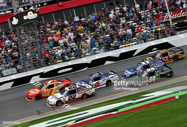 Regan Smith driver of the Ragu Chevrolet crosses the finish line ahead of Brad Keselowski driver of the Discount Tire Ford to win the NASCAR...