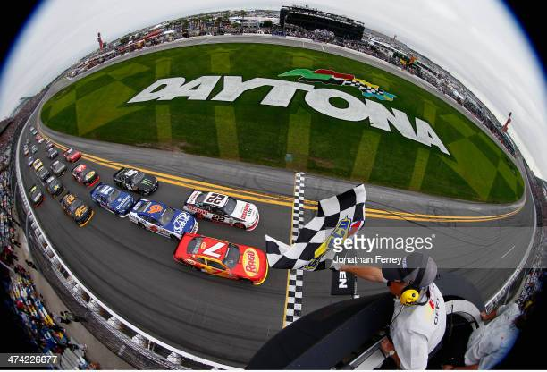 Regan Smith driver of the Ragu Chevrolet races to the checkered flag ahead of Brad Keselowski driver of the Discount Tire Ford to win the NASCAR...