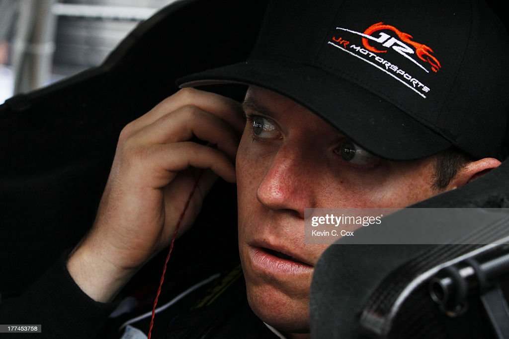 Regan Smith, driver of the #7 TaxSlayer.com Chevrolet, adjusts his equipment in his car during practice for the NASCAR Nationwide Series Food City 250 at Bristol Motor Speedway on August 23, 2013 in Bristol, Tennessee.