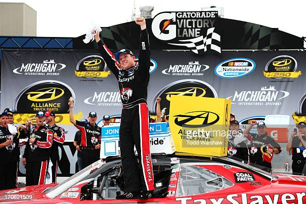 Regan Smith driver of the TaxSlayercom Chevrolet celebrates in Victory Lane after winning the NASCAR Nationwide Series Alliance Truck Parts 250 at...