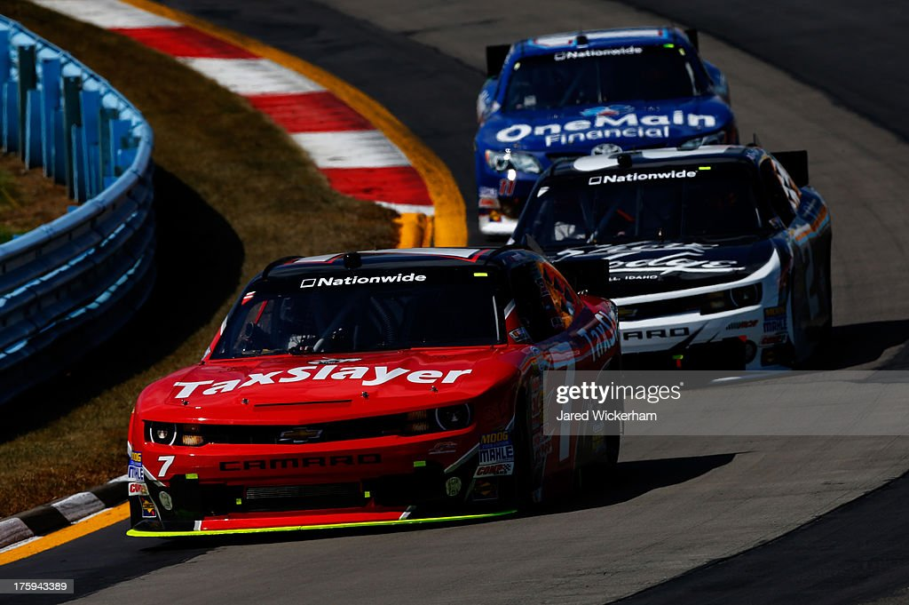 <a gi-track='captionPersonalityLinkClicked' href=/galleries/search?phrase=Regan+Smith&family=editorial&specificpeople=564271 ng-click='$event.stopPropagation()'>Regan Smith</a>, driver of the #7 TaxSlayer.com Chevrolet, leads a pack of cars during the NASCAR Nationwide Series Zippo 200 at Watkins Glen International on August 10, 2013 in Watkins Glen, New York.