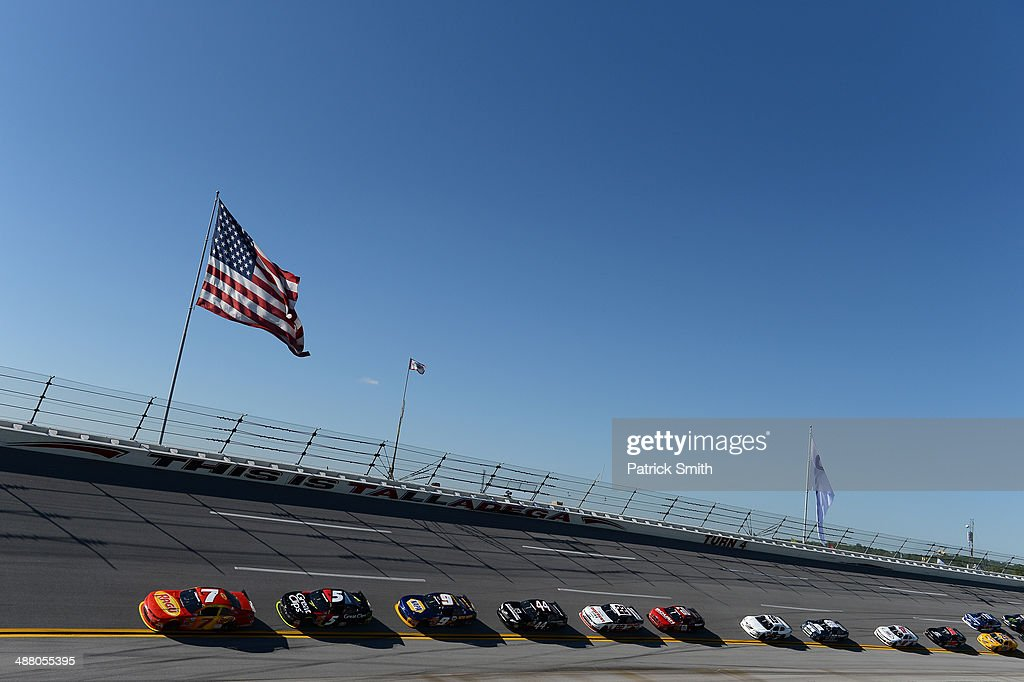 Regan Smith, driver of the #7 TaxSlayer.com Chevrolet, leads a pack of cars during the NASCAR Nationwide Series Aaron's 312 at Talladega Superspeedway on May 3, 2014 in Talladega, Alabama.