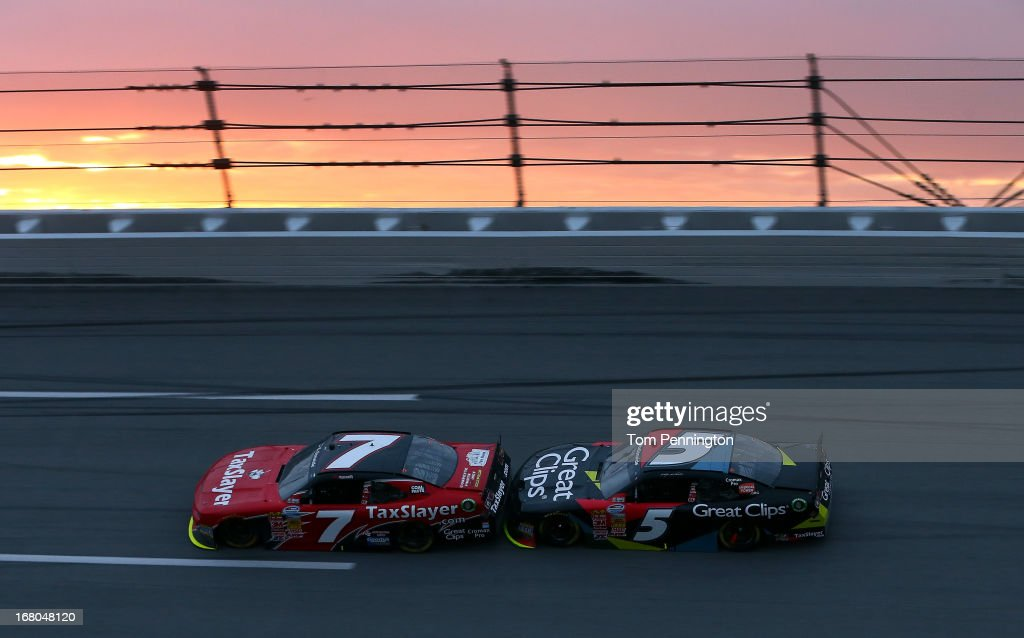 Regan Smith driver of the TaxSlayercom Chevrolet leads Kasey Kahne driver of the Great Clips Chevrolet during the NASCAR Nationwide Series Aaron's...