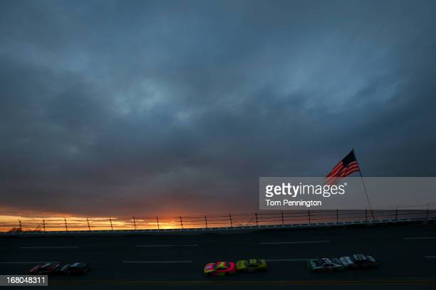 Regan Smith driver of the TaxSlayercom Chevrolet leads the field during the NASCAR Nationwide Series Aaron's 312 at Talladega Superspeedway on May 4...