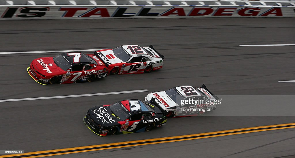 Regan Smith, driver of the #7 TaxSlayer.com Chevrolet, Sam Hornish Jr., driver of the #12 Wurth Ford, Kasey Kahne, driver of the #5 Great Clips Chevrolet, and Joey Logano, driver of the #22 Discount Tire Ford, race through turn four during the NASCAR Nationwide Series Aaron's 312 at Talladega Superspeedway on May 4, 2013 in Talladega, Alabama.