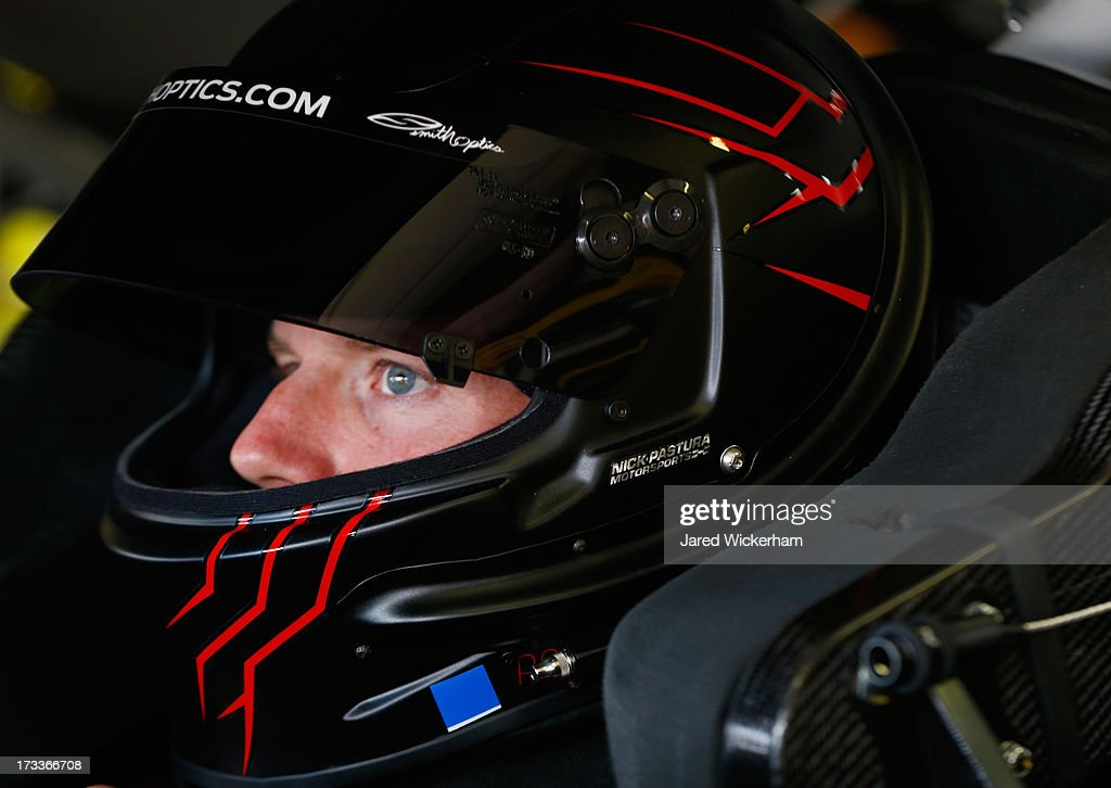 <a gi-track='captionPersonalityLinkClicked' href=/galleries/search?phrase=Regan+Smith&family=editorial&specificpeople=564271 ng-click='$event.stopPropagation()'>Regan Smith</a>, driver of the #7 TaxSlayer.com Chevrolet, sits in his car during practice for the NASCAR Nationwide Series CNBC Prime's 'The Profit' 200 at New Hampshire Motor Speedway on July 12, 2013 in Loudon, New Hampshire.