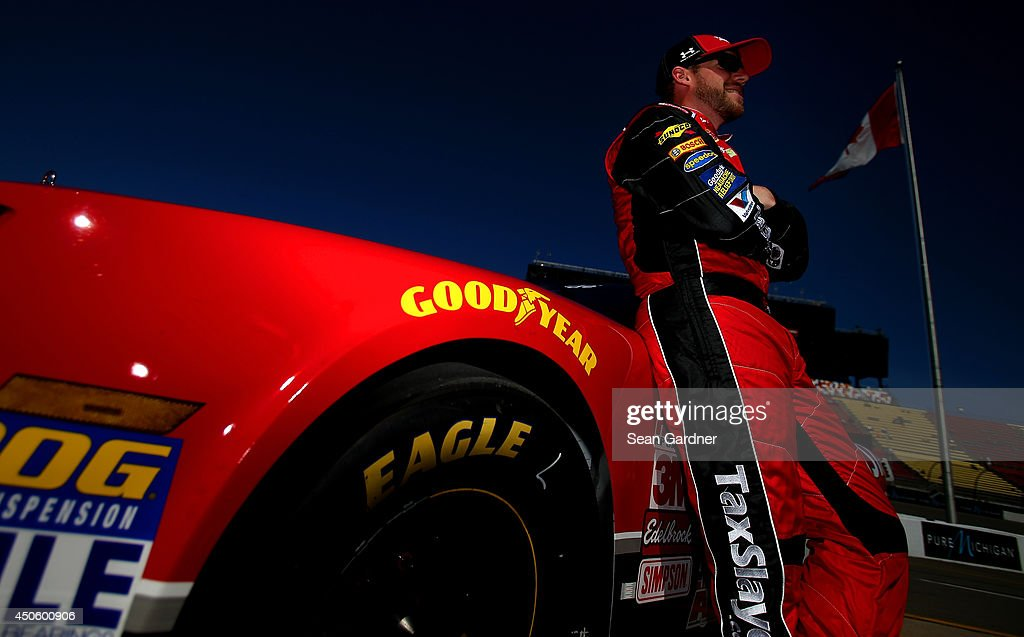 Regan Smith, driver of the #7 TaxSlayer.com Chevrolet, stands on the grid during qualifying for the NASCAR Nationwide Series Ollie's Bargain Outlet 250 at Michigan International Speedway on June 14, 2014 in Brooklyn, Michigan.
