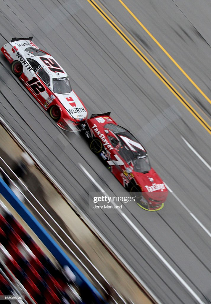 Regan Smith driver of the TaxSlayercom Chevroletleads Sam Hornish Jr driver of the Wurth Ford during the NASCAR Nationwide Series Aaron's 312 at...