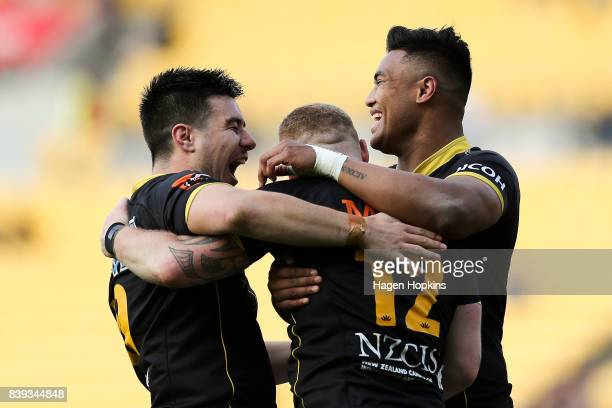 Regan Verney of Wellington celebrates after scoring a try with teammates Jackson GardenBachop and Julian Savea during the round two Mitre 10 Cup...
