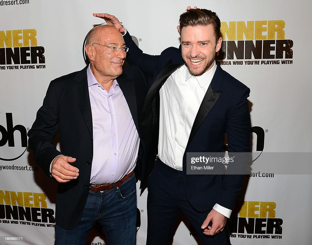 Regency Chairman Arnon Milchan (L) and singer/actor Justin Timberlake joke around as they arrive at the world premiere of Twentieth Century Fox and New Regency's film 'Runner Runner' at Planet Hollywood Resort & Casino on September 18, 2013 in Las Vegas, Nevada.
