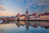 Cityscape image of Regensburg, Germany during sunset.
