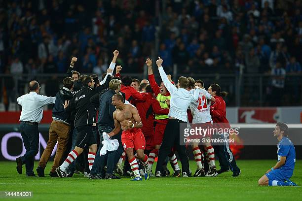 Regensburg players celebrate after winning the Second Bundesliga relegation match between Karlsruher SC and Jahn Regensburg at Wildpark Stadium on...