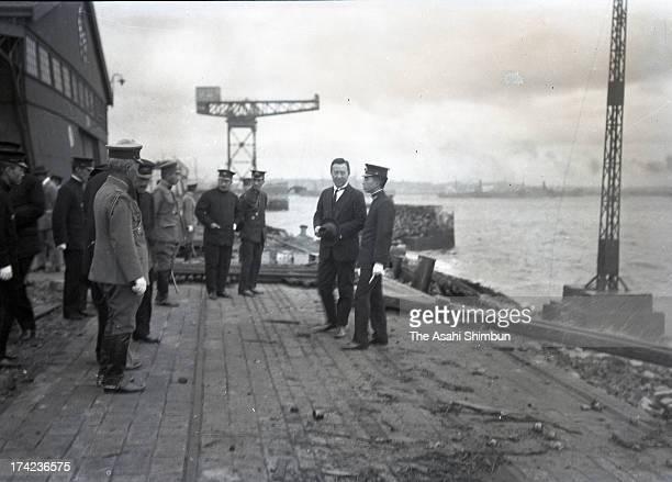 Regent Hirohito inspects the damage of Yokohama Port after the Great Kanto Earthquake on October 10 1923 in Yokohama Kanagawa Japan The estimated...