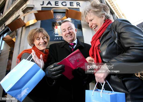 Regent Street Butler Tony Sutton helps June Knowles and Kay Durant with their shopping on Regent Street London as part of the launch of the new...