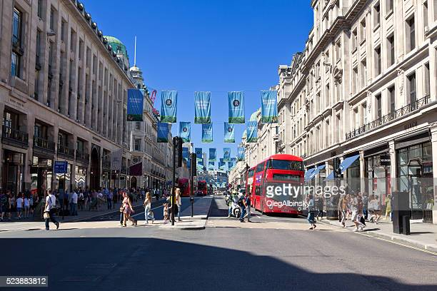 Regent Street with Red Double Decker Bus and Tourists, London.