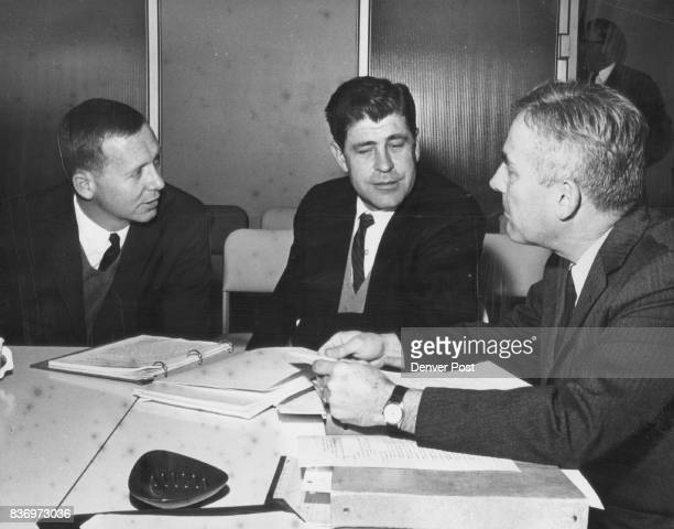 Regents President Listen to word Battle over firing Left to right are Regents Philip A Danielson and Dr Dale W Atkins and President Quigg Newton...