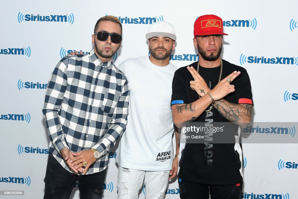 Reggaeton duo Fido (L) and Alexis (R) of 'Alexis Y Fido' with singer Nacho (C) at SiriusXM Studios on August 21, 2017 in New York City.