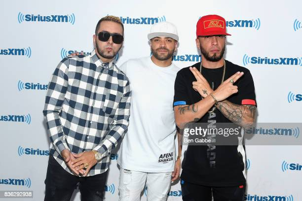 Reggaeton duo Fido and Alexis of 'Alexis Y Fido' with singer Nacho at SiriusXM Studios on August 21 2017 in New York City