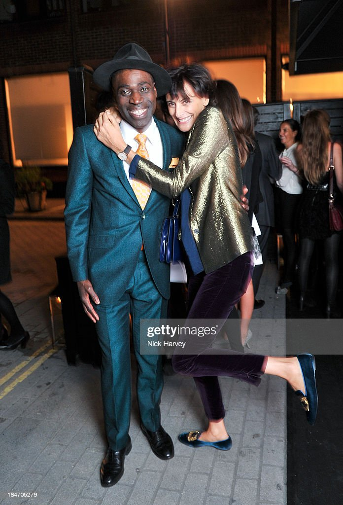 Reggie Ansah and Ines De La Fressange attend the Roger Vivier Virgule party at Le Baron on October 15, 2013 in London, England.