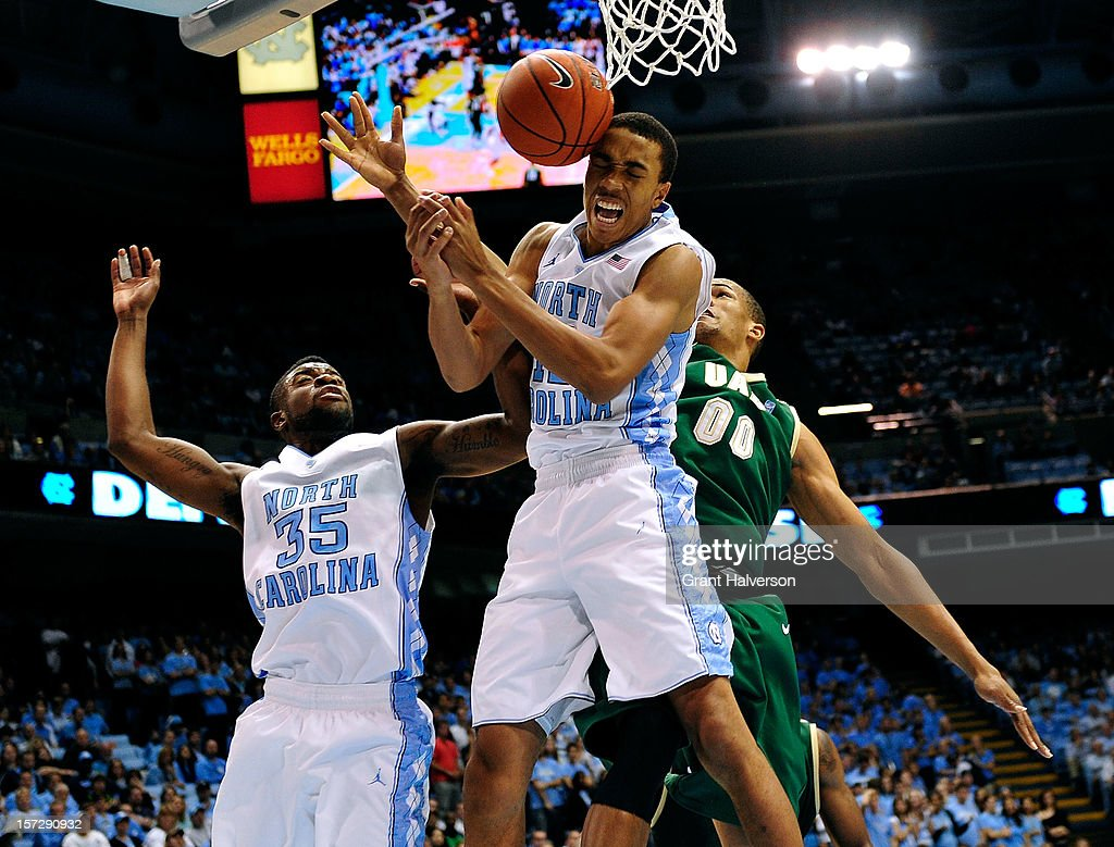 Reggie Bullock #35 and Brice Johnson #11 of the North Carolina Tar Heels battle for a rebound with Alexander Scotland-Williams #00 of the UAB Blazers during play at the Dean Smith Center on December 1, 2012 in Chapel Hill, North Carolina.
