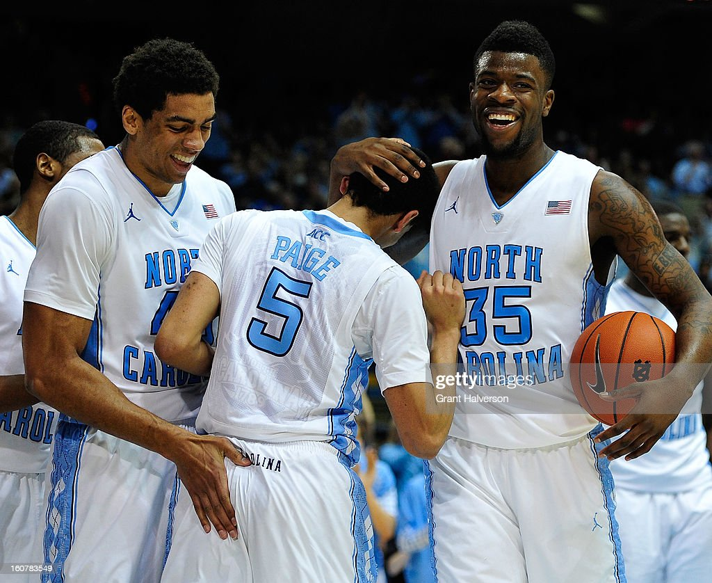 Reggie Bullock #35 and James Michael McAdoo #43 congratulate teammate Marcus Paige #5 of the North Carolina Tar Heels after hisbasket abd foul against the Wake Forest Demon Deacons during play at the Dean Smith Center on February 5, 2013 in Chapel Hill, North Carolina. North Carolina won 87-62.