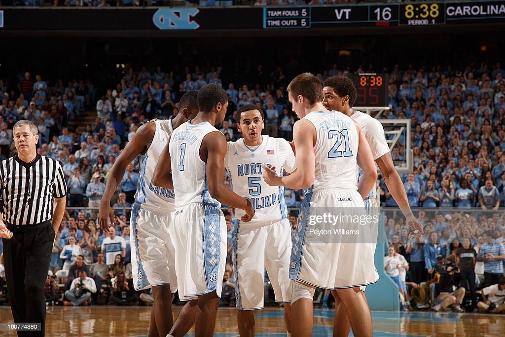 Reggie Bullock #35, Dexter Strickland #1, Marcus Paige #5, Jackson Simmons #21 and James Michael McAdoo #43 of the North Carolina Tar Heels talk during a game against the Virginia Tech Hokies on February 02, 2013 at the Dean E. Smith Center in Chapel Hill, North Carolina. North Carolina won 72-60 in overtime.