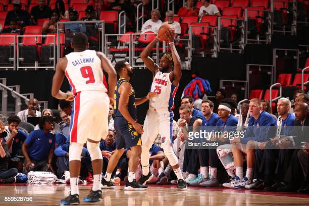 Reggie Bullock of the Detroit Pistons handles the ball against the Indiana Pacers on October 9 2017 at Little Caesars Arena in Detroit Michigan NOTE...