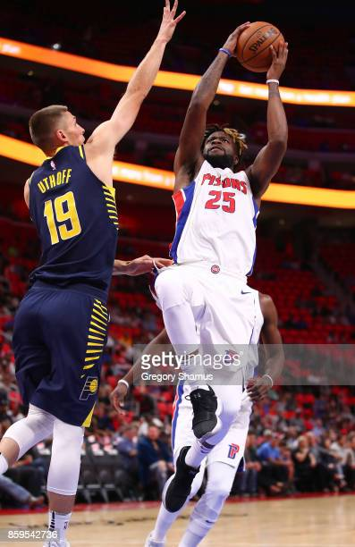 Reggie Bullock of the Detroit Pistons tries to get off a shot past Jarrod Uthoff of the Indiana Pacers during a pre season game at Little Caesars...