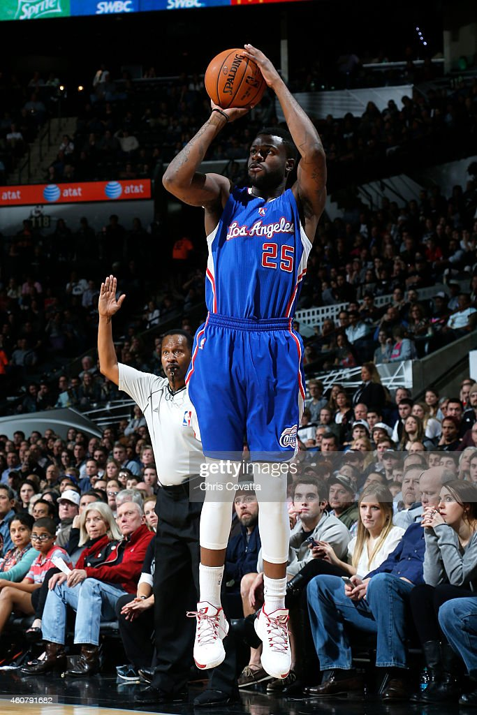 Reggie Bullock #25 of the Los Angeles Clipper takes a shot against the San Antonio Spurs on December 22, 2014 at the AT&T Center in San Antonio, Texas.