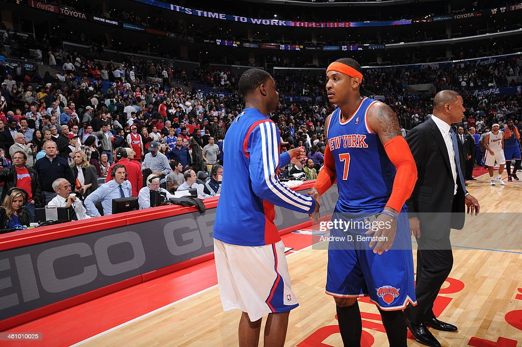 Reggie Bullock #25 of the Los Angeles Clippers and <a gi-track='captionPersonalityLinkClicked' href=/galleries/search?phrase=Carmelo+Anthony&family=editorial&specificpeople=201494 ng-click='$event.stopPropagation()'>Carmelo Anthony</a> #7 of the New York Knicks shake hands after a game with the New York Knicks at Staples Center on November 27, 2013 in Los Angeles, California.
