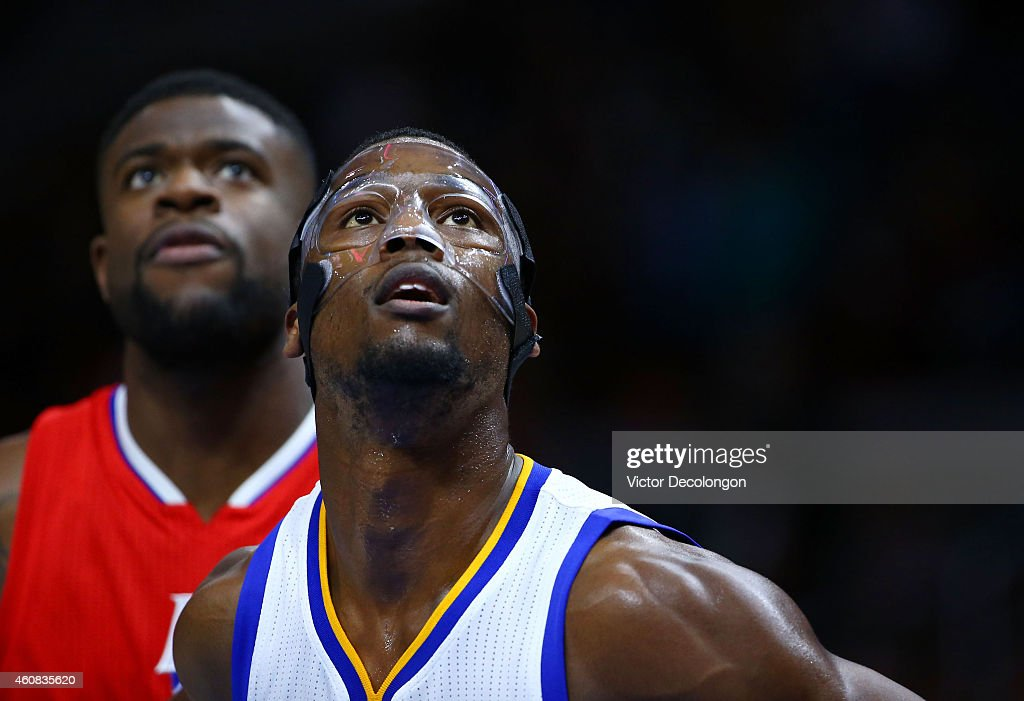 Reggie Bullock #25 of the Los Angeles Clippers and Harrison Barnes #40 of the Golden State Warriors (R) watch the ball during a free throw during the second half of the NBA game at Staples Center on December 25, 2014 in Los Angeles, California.