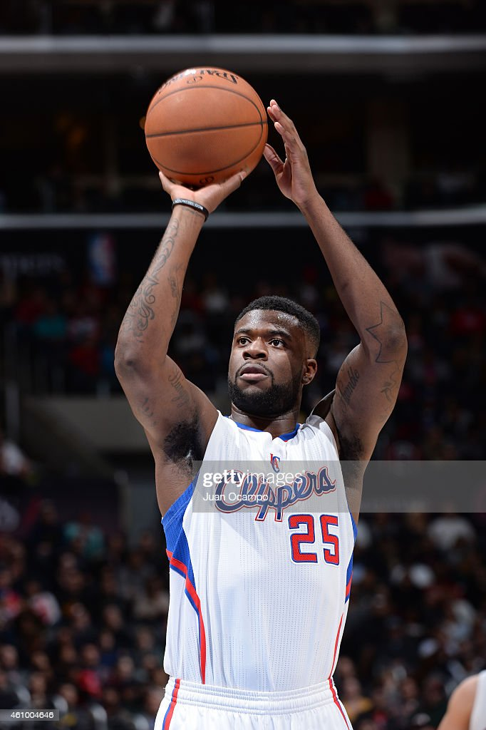 <a gi-track='captionPersonalityLinkClicked' href=/galleries/search?phrase=Reggie+Bullock+-+Basketballer&family=editorial&specificpeople=10584530 ng-click='$event.stopPropagation()'>Reggie Bullock</a> #25 of the Los Angeles Clippers shoots against the Philadelphia 76ers during the game on January 3, 2015 at STAPLES CENTER in Los Angeles, California,