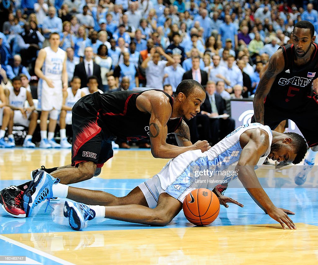 Reggie Bullock #35 of the North Carolina Tar Heels battles for a loose ball with Lorenzo Brown #2 and <a gi-track='captionPersonalityLinkClicked' href=/galleries/search?phrase=C.J.+Leslie&family=editorial&specificpeople=6902920 ng-click='$event.stopPropagation()'>C.J. Leslie</a> #5 of the North Carolina State Wolfpack during play at the Dean Smith Center on February 23, 2013 in Chapel Hill, North Carolina. North Carolina won 76-65.