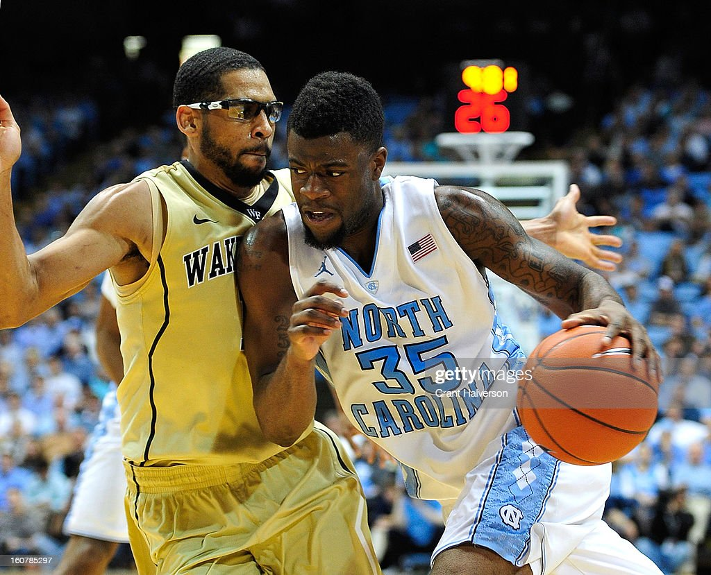 Reggie Bullock #35 of the North Carolina Tar Heels drives against C.J. Harris #11 of the Wake Forest Demon Deacons during play at the Dean Smith Center on February 5, 2013 in Chapel Hill, North Carolina. North Carolina won 87-62.