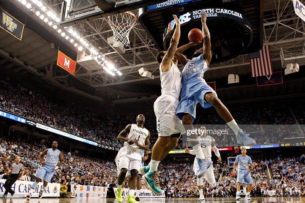 Reggie Bullock #35 of the North Carolina Tar Heels drives for a shot attempt in the first half against Kenny Kadji #35 of the Miami (Fl) Hurricanes during the final of the Men's ACC Basketball Tournament at Greensboro Coliseum on March 17, 2013 in Greensboro, North Carolina.