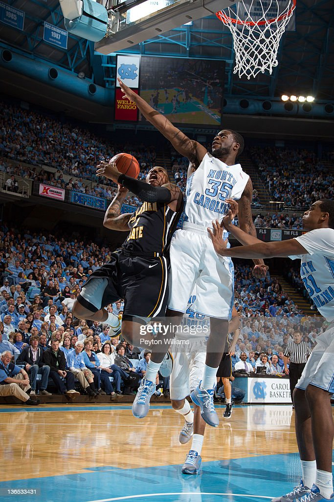 Reggie Bullock of the North Carolina Tar Heels guards Rodney Milum of the Appalachian State Mountaineers on December 17 2011 at the Dean E Smith...
