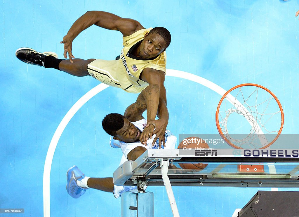 Reggie Bullock #35 of the North Carolina Tar Heels is fouled on a drive to the basket by Arnaud William Adala Moto #45 of the Wake Forest Demon Deacons during play at the Dean Smith Center on February 5, 2013 in Chapel Hill, North Carolina. North Carolina won 87-62.